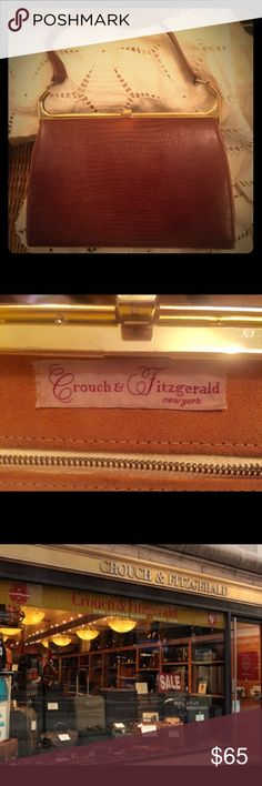 """Crouch & Fitzgerald 1950's Luxury Lizard Handbag Crouch & Fitzgerald luxury brand dates back to the 1800's & originally made their name with steamer trunks & travel bags. Times change, but their standards never did. This fabulous purse is very vintage, and is made of genuine Lizard, with imported suede leather interior. Brass hardware stamped """"elbief England"""" Fabulous frame shape! Interior has stray pen mark & dark 1/2""""x2"""" dark stain. Condition: Exterior shows wear on all 4 lower corners…"""