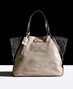 What's new at Macy's Herald Square? This DKNY python-print studded bag to start!