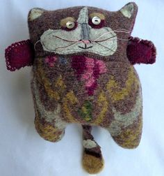 Hand crafted plush cat made from vintage upcycled sweaters with mother of pearl eyes. Hand and machine stitched, felted wool, heart tattoo. on Etsy, $62.00
