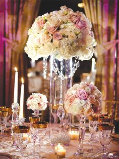 I like the crystals on this and I like the tall clear cylindar..... maybe I'll do that instead of the candleabra.