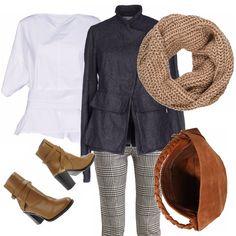 La giacca di panno grigio con collo alla coreana e allacciatura asimmetrica ha un suo stile, quasi ottocentesco. Il pantalone principe di Galles è un po' desueto ma ben si abbina alla giacca. Blusa bianca che non manca mai. In questo caso anziché assecondare il colore grigio abbiamo scelto accessori cuoio. Lo stivaletto, la borsa ed il collare di lana perchè ci piacciono in contrasto