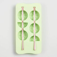 Create a pair of frozen fruit slice-shaped kabobs with our silicone ice cube tray. A fun novelty gift, the flexible silicone tray includes two swizzle sticks that freeze into long ice cube stacks that you can use to mix, cool and flavor cocktails and other beverages. Cost Plus World Market Fruit Slice Swizzle Stick Silicone Ice Cube Tray #ice #icecube #kitchen #drinks #colddrinks #affiliate