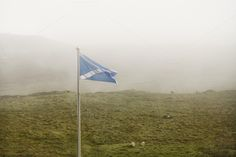Scottish flag in the fog by Patricia Hofmeester on Creative Market