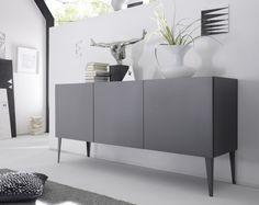 #Madia moderna dal design minimal, con gambe a spillo. La #struttura ed i frontali sono realizzati con finitura grigio opaco con #maniglie incassate.