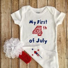 Celebrate baby's first Fourth of July milestone with this one piece onesie. Can be purchased with a coordinating headband or by itself.