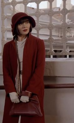 Phyne's smart red coat and cloche in Cocaine Blues - Miss Fisher's Murder Mysteries - Series 1 Episode 1 - Phryne Fisher fashion