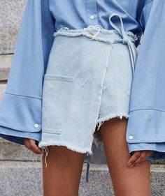 Two tone denim styling gets a summer update with this frayed denim wrap skirt