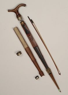 A rare and important violin gadget cane - by Tradewinds Antiques