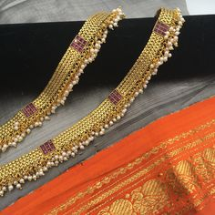 Payal - Thick golden band with pearls and red stones