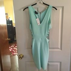 BeBe new baby blue dress • NWT • Baby blue bandage type dress with cutouts on the ribcages • bebe Dresses Mini