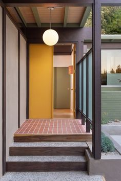 Restored Calvin Straub Post-And-Beam by HabHouse - Dwell door Photo 2 of 16 in A Thoughtfully Restored Pasadena Post-and-Beam Lists… House Design, House, Yellow Doors, Modern Door, Modern House, House Exterior, Modern, Mid Century Exterior, Modern House Exterior
