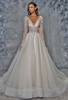 Eve of Milady. Beaded tulle ball gown with long illusion sleeves, deep V-neckline and full A-line skirt.