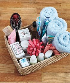 Hospitality basket of bathroom items. A supply of just-in-case items for overnight guests, including a scented candle and an alarm clock.