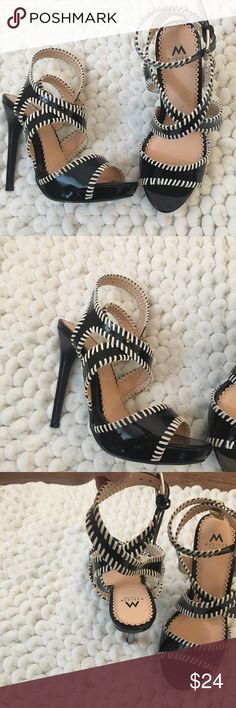 Black & white criss cross strappy heels 8 Beautiful heels by shoe dazzle. Black patent with white stitching book. Only worn one time. Heel is approximately 5.5 inches. Like new. ShoeDazzle Shoes Heels