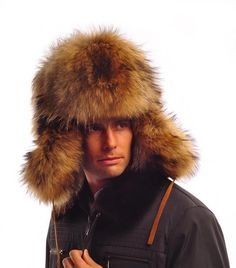 Russian Furs: Men's Russian Raccoon Fur Winter Hats  Russian Hat. made from real raccoon fur. Authentic and traditional, this amazing hat is hand-made. are the highest quality to be found anywhere. BIG and BOLD, the Hat is anything but understated. Raccoon fur is brownish in color with black tips. This classic Russian hat has ear flaps that can be worn down for extra warmth or folded up and tied together at the top of the head.
