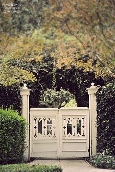 Distinctive cut-outs in the symmetrical gateway doors and tall posts give this entrance a strongly formal presence. Door Gate, Fence Gate, Fences, Garden Gates And Fencing, Garden Paths, Portal, Old Gates, Modern Garden Design, Garden Architecture