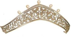 a pear-shaped pearl, diamond and gold floral/foliate tiara, made by Carrera y Carrera. History http://www.carreraycarrera.com/en/the-brand/history