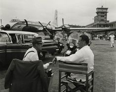 """Fantastic Photos Of Vintage Cuba Show Life Before Castro  Actor Alec Guinness and director Carol Reed chat on the set of """"Our Man in Havana"""" at the José Martí airport in 1959 Read more at http://all-that-is-interesting.com/vintage-cuba#8rZ2CbocMkiYHZYG.99  Read more at http://all-that-is-interesting.com/vintage-cuba#8rZ2CbocMkiYHZYG.99"""