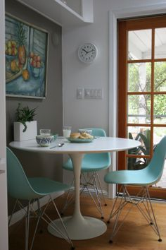 I like the bright, retro-style chairs against the white table and dove gray walls.