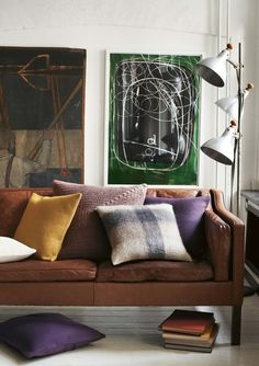 Subdued colours with mid-century tan leather sofa. So very easy going...