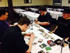 The volunteers throw down some Commander before people arrived for the FRF Midnight Pre-Release.