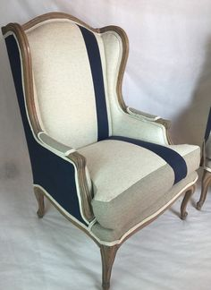 These chairs have sold but if you are interested in replicating them on a similar set of chairs please contact me for options. The wood has been stiped of stain and restained with grey accents. Three fabrics were used on this chair, an organic bamboo extra soft woven beige fabric with grey weaving, navy linen and a taupe fabric. All foam and padding has been replaced and a down cover was added to make it extra soft but still able to retain its shape. The stripe was seen in to make a custom…