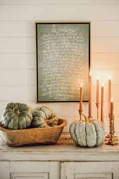 Another fall decor inspiration photo with neutral decor ideas. Not your everyday orange and black halloween decorations. burnt orange candle sticks and fun muted green pumpkins for the win!