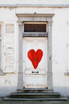 A simple, red heart painted on a white door takes it from drab to adorable!  A work of art in San Diego.  front doors.  hearts. travel. united states. California. doors. doors of the world. door art.