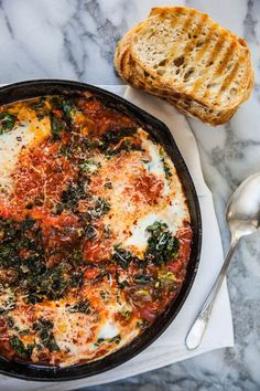 FARM EGGS WITH BRAISED GREENS & TOMATO. My mom makes this recipe all the time! Mmmmmm!