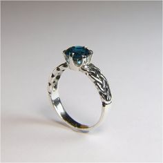 London Blue Topaz, Round Cut, 1.25 carats x 7mm, Sterling Silver Ring. $90.00, via Etsy.