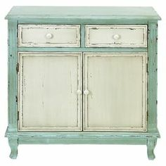 "Antiqued cabinet in distressed green with 2 ivory drawers and 2 doors.    Product: CabinetConstruction Material: Compressed wood Color: Distressed green and ivory Features: Two drawers and two doors Dimensions: 33"" H x 33"" W x 14"" D"