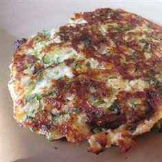 Low Carb Zucchini Pancakes: 1lb zucchini, .25 C Parm, 2 eggs, 3 cloves garlic, 4 basil leaves, seasonings. (I set my zucchini aside and let the water come out first by lightly salting them. Then softly squeezing out the excess water)