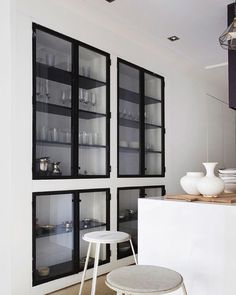 I love these built in cabinets with metal doors. I have always love it as book case but how gorgeous is this in the kitchen. XxxF by…