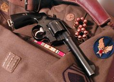 Colt New Service 1917 Army with buffalo horn grips. It's a re-blue but i love it. Displayed on my grandfather's AAF uniform. Survival Equipment, Survival Tools, Shooting Sports, Guns And Ammo, Dog Houses, Old West, Pistols, Usmc, Firearms