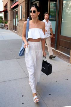 Lily Aldridge nails mid-summer style with matching white separates from Reformation. The white cotton crop and matching maxi skirt keep her cool - in more ways than one. We can't wait to recreate.