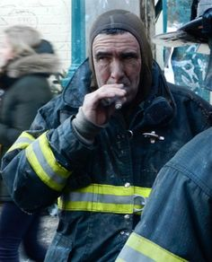 Four-Alarm Fire Rages On Main Drag Of Williamsburg's Bedford Avenue, firefighter takes a well earned stogie break