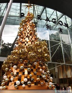 Glitter and gold mod alternative tree.  Modern, minimal Christmas, inspiration from Retail holiday decorations.