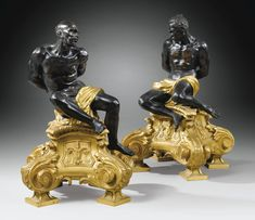 """A PAIR OF PATINATED AND GILT-BRONZE SLAVES FIREDOGS, AFTER A MODEL BY PIETRO TACCA, IN 17TH CENTURY TASTE-20-1/2"""" high 