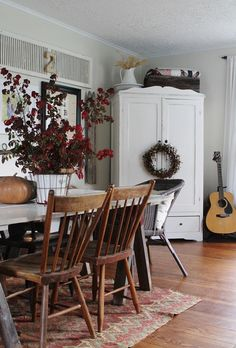 Farmhouse Dining Room with Painted Cupboard                              …
