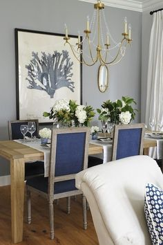 Kerrisdale Design - dining rooms - 6 Light Marigot Chandelier, navy dining chairs, navy blue dining chairs, square back dining chairs, navy square back chairs, rectangular dining table, gray walls, gray dining room walls, gray walls in dining room, marigot chandelier, 6 light chandelier, visual comfort lighting chandelier, antique brass chandelier, blue coral art, french dining chairs, by marisa