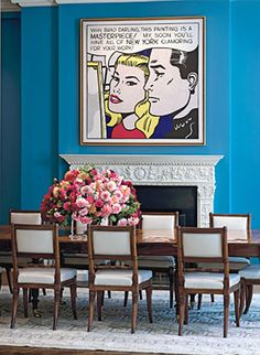 fun art and bright blue walls in a stuffy dining room