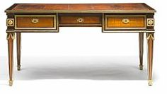 French Louis XVI gilt bronze mounted amaranth, rosewood and parquetry bureau plat, ascriped to Philippe-Claude Montigny (1734-1800).