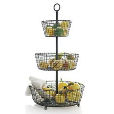 """Tiered display and serving baskets are handcrafted of iron wire in a distinctive rustic """"weave"""" and finished in a multistep process of zinc plating, dipping and rubbing to create the beautiful, dark antiqued patina."""
