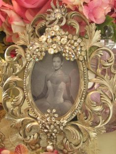 Exquisite Scrolly Gold vintage jeweled Frame- DIY idea! I think you could creat something similar by glueing jewelry onto a frame. Very pretty!
