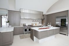 Suzie: Design Galleria - Modern gray kitchen with gray kitchen cabinets & kitchen island with ...