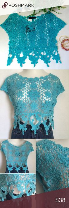 "LF Story of Lola crochet top NWT Story Of Lola floral crochet crop top with crochet lace hem from LF. Pretty, bright aqua color. Size is labeled OS, but best for XS-S. Measures 18"" across. Length is 13"" to bottom of floral pattern from shoulder and 18.25"" overall length to bottom of crochet lace trim. 100% cotton. Not interested in trades. NWT LF Tops Crop Tops"