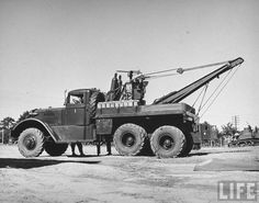 Tow Truck!  10-ton wrecker truck used to haul light tanks.   george strock  1942  Life archive