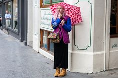 The designer Carri Mundane shows us that a cute printed umbrella can be a great statement accessory. #Topshop #prints #lovehearts #carrimundane