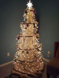 Tired of dealing with the mess & hassle of a Christmas tree fake/real pine needles and storage issue. I was inspired to create a Hula Hoop Chandelier style Christmas tree. Even better is when I collapse the tree it wont take up hardly any room at all.