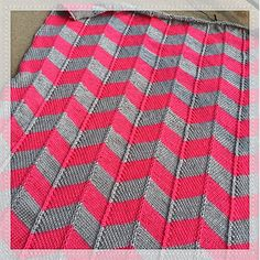 A modern Chevron knit baby blanket, using as many colors as you choose! (the pattern and materials are written for a two color blanket)